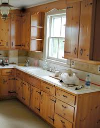 appealing brown color plywood kitchen cabinets with double door