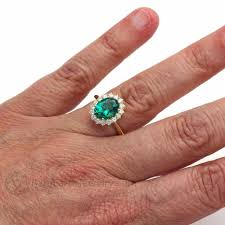 emerald engagements rings images Vintage style emerald ring oval diamond halo cluster may jpg