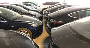 why are dozens of tesla model 3 s and x sitting in an la parking
