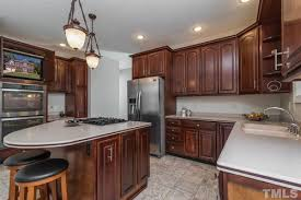 what color cabinets with beige tile busy pink beige tile floor what color for countertops