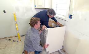 install base cabinets before flooring how to install kitchen cabinets the home depot