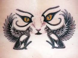 an egyptian hieroglyph tattoo of cats with wings and cats eyes a