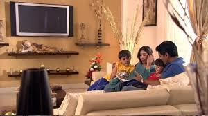 Family  Reading  Living Room  India HD Stock Video - Family in living room