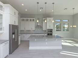 good looking white shaker kitchen cabinets grey floor white