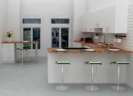 stylish open kitchen peninsula design with mini bar seating