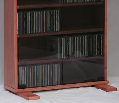 dvd rack with 72 inch glass doors in maple with minwax sedona red
