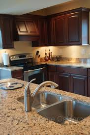 astounding venetian gold granite kitchen backsplash featuring l