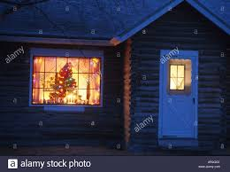 log cabin christmas tree in window matsu valley ak winter