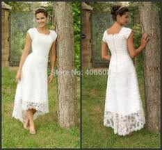 tea length white bridal gown in charming lace with asymmetrical