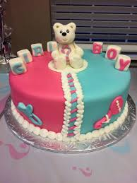 gender reveal baby shower cake with converse shoes and booties