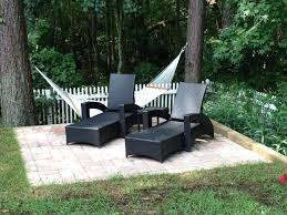 outdoor reading chair belgard paver tile overlay expands existing concrete patio in