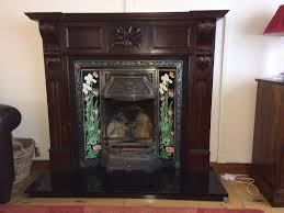 fire place and surround victorian dark wood black granite