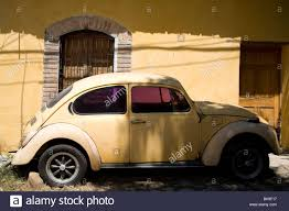 yellow volkswagen beetle royalty free orange volkswagen beetle car parked outside an orange painted