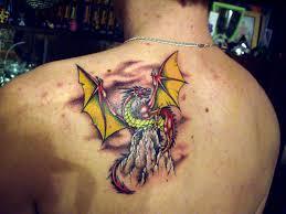 63 outstanding wings shoulder tattoos