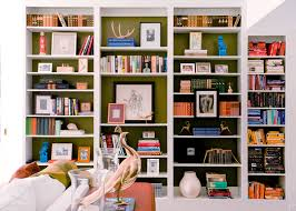 built in bookshelves full of things contrasting color painted in