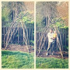 Backyard Teepee Tiptoethrough Diy Outdoor Teepee With Branches And Flowers
