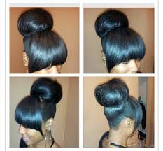 curly hair in high bun with bang high bun with bangs hair pinterest high bun bangs and hair style
