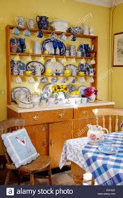blue and white china on dresser in yellow dining room with blue
