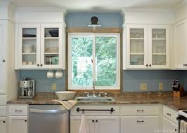 kitchen cabinets above sink install a sconce light above the kitchen sink