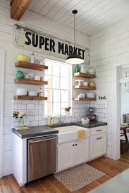 joanna gaines farmhouse kitchen with cabinets 9 creative ways to decorate the tops of your kitchen cabinets