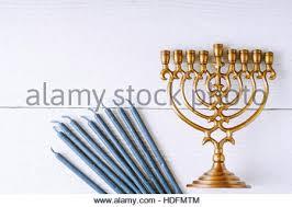 wooden menorah hanukkah menorah with candles green background isolation stock