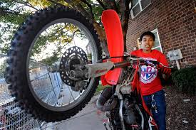 how to wheelie a motocross bike in popular u2013 but illegal u2013 baltimore dirt bike scene female rider