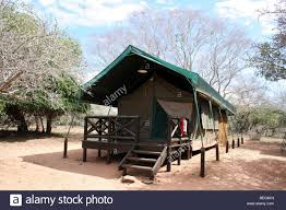 camping in africa with wooden shelter cabin in desert sunrise