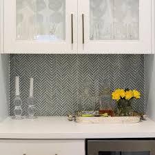 Butlers Pantry With Herringbone Backsplash And Gray Glassfront - Herringbone tile backsplash
