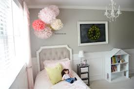 Pictures To Hang In Bedroom by Tissue Paper Pom Poms Tutorial The Idea Room