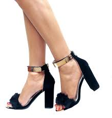 black heels with gold ankle cuff is heel