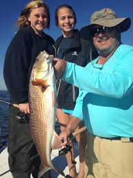 Cape Cod Kids Fishing - teenage girls and dad catching redfish perfect cast charters