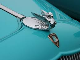 vintage aqua car with winged goddess on the front yes