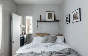10 small bedroom ideas that are big in style freshome com 2 push your bed up against a corner