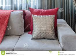 Red Pillows For Sofa by Grey Sofa With Red Pillow In Living Room At Home Stock Photo
