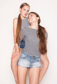 cute teenagers two cute teenagers having fun together isolated on white stock photo