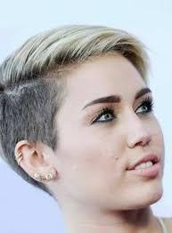two ear hairstyle 10 best known miley cyrus piercings body art guru
