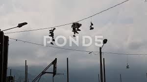 video pairs of shoes hanging on electrical wires in medellin