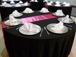 black linens silver charger plates pink satin runners