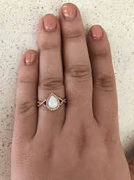 rose gold pear shape white opal stone engagement infinity band