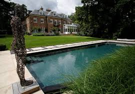 in ground swimming pool concrete natural outdoor surrey