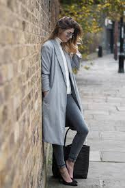 chic winter outfit grey coat cream jumper are skinny jeans