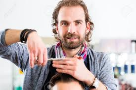 barber trimming man hair in haircutter shop stock photo picture