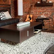 living room rugs 2017 with amazing decoration amaza design dark brown table on living room rugs and black sofa beside floor lamp
