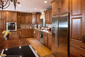 Cognac Kitchen Cabinets by Cabinets Showplace Chesapeake Creates Timeless Warmth In Red Oak