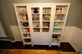 our new china cabinet set up ikea hemnes glass door cabinet the center cabinet holds my china set and a few other pieces we definitely have room to grow