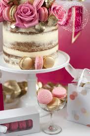 pink and gold macaron studded birthday cake