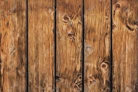 rustic wood photograph of antique rustic pine wood fence detail stock photo
