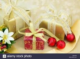 christmas presents with flower decoration red baubles gold