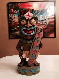 tiki holding welcome surfboard from tree shop 2014 the