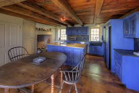 blue kitchen cabinets in cabin 11 gorgeous country kitchens for your decorating inspiration